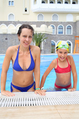 Happy woman and girl (with model release) in swimsuits in the swimming pool of the Hotel Bogatyr