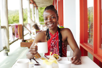Black woman smiling at lunch