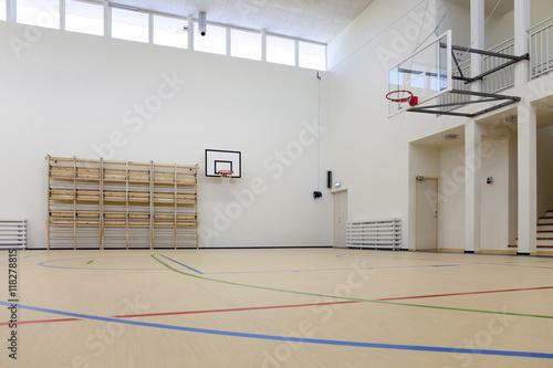 Empty indoor basketball court\