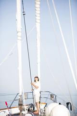 Caucasian woman standing on sailboat deck
