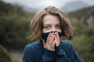 Caucasian woman wearing turtleneck sweater outdoors