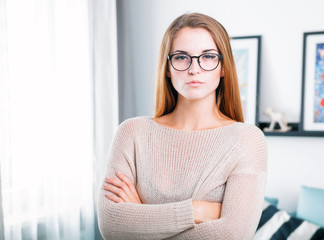 Young beautiful woman with eyeglasses at home