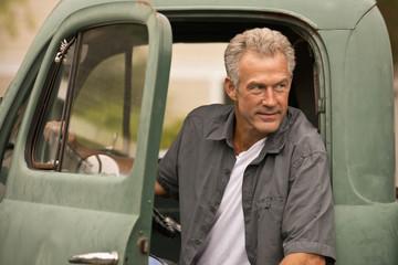 Caucasian farmer sitting in truck