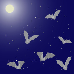 Flying bats in the night sky with the moon and stars