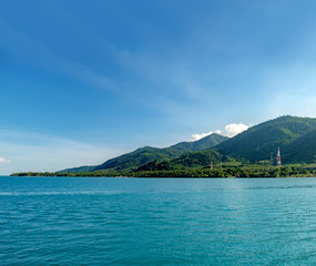 Beautiful scenery looking the islands from ferry. Tropical landscape over sea with cloudy bright sky, Koh Chang island,Thailand.