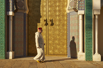 Caucasian man walking by ornate temple