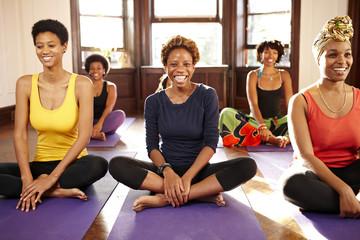 Women smiling in yoga class