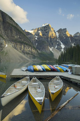Colorful canoes on dock of Moraine Lake