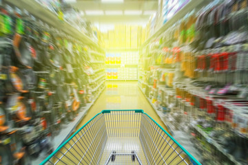 Running shopping cart in supermarket