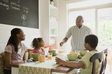 African American family eating breakfast