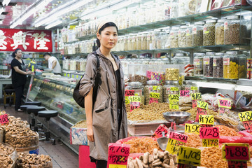Asian woman shopping in grocery store