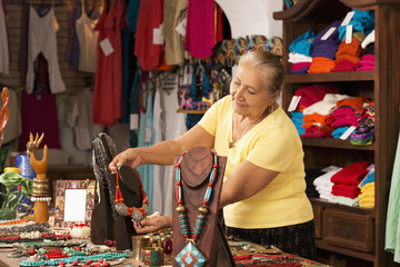 Smiling woman working in traditional gift shop