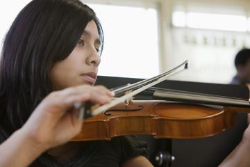 Hispanic student practicing on violin