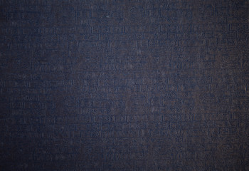 Hieroglyph texture closeup. Grunge paper with hieroglyphics with magnifier closeup. Nice background for any ideas.