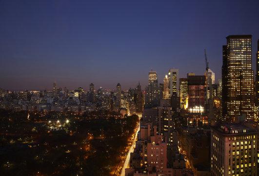 Sunset and illuminated cityscape, New York, New York, United States
