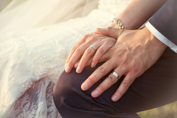 Цlose-up of a bride and groom hands with wedding rings