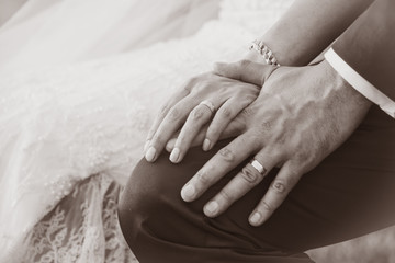 Close-up of a bride and groom hands with wedding rings (Sepia tones)