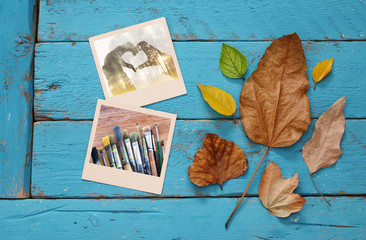 Autumn background with dry leaves and old photo frames
