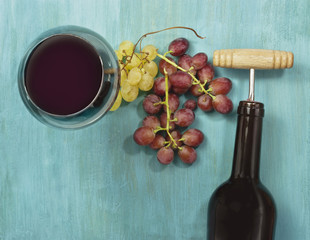 Wine background with glass, grapes, bottle, and copyspace