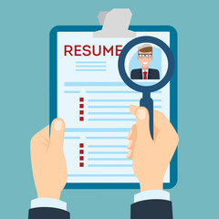 Resume with magnifier at the table. Cv resume concept. Finding a worker. Apply for a job. Business opportunity. Cv profile.