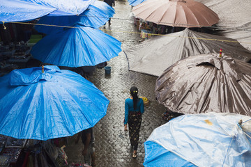 Rain falling over tarps and awnings of market stalls, Ubud, Bali, Indonesia