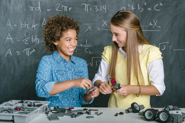 Students building vehicle in science class
