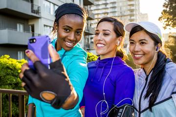 Runners taking selfie on in city