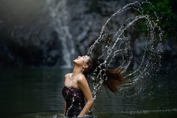 Beautiful young woman at swimming pool.