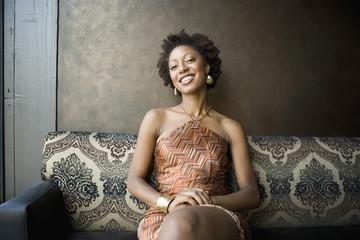 African woman sitting in nightclub