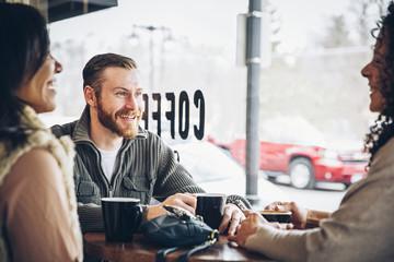 Friends drinking coffee in cafe