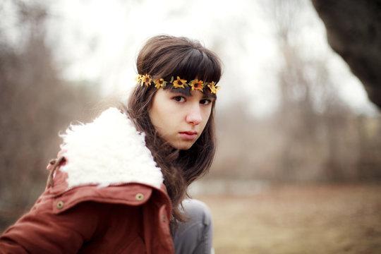 Serious Caucasian woman wearing flower crown