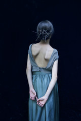 Rear view of woman wearing evening gown
