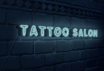 Sign Tattoo Salon on brick wall background