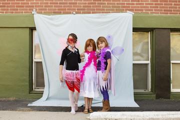 Portrait of Caucasian girls in costumes outdoors