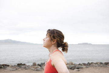 Portrait of tired woman on beach