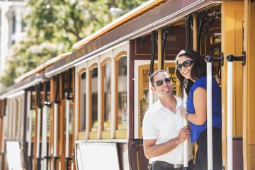Hispanic couple riding cable car