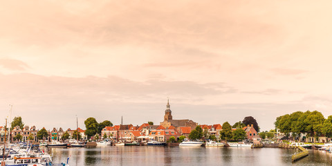 View at the historic harbor with yachts in the Dutch village of