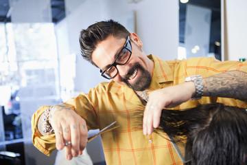 Hairdresser cutting hair in salon