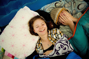 Couple laughing in camping tent