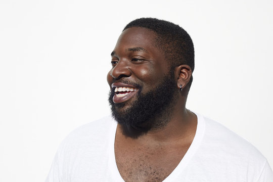 Close up of smiling Black man with beard