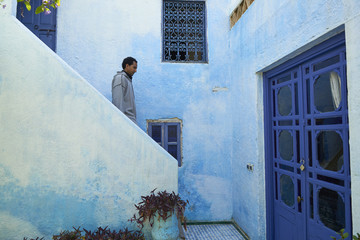 Man walking on painted stairs, Fes, Fes-Boulemane, Morocco