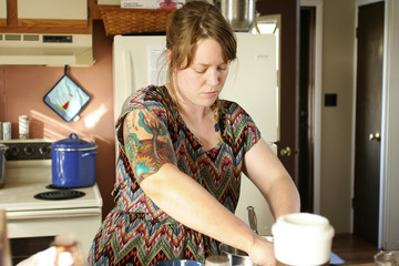 Focused woman cooking in kitchen