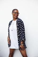 Stylish Black woman posing in dress