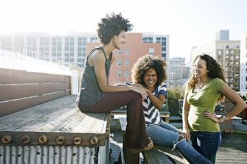 Women relaxing on urban rooftop