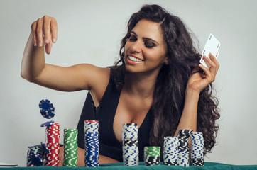 Happy beautiful brunette, poker win