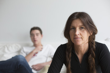 Caucasian mother and son sitting in living room