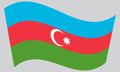 Flag of Azerbaijan waving on gray background