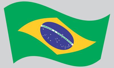 Flag of Brazil waving on gray background