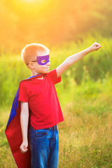 Child playing super hero and super man
