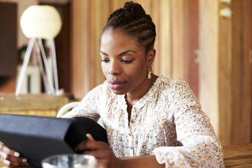 Black woman using tablet computer